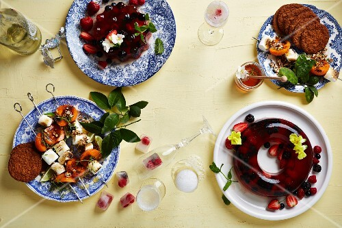 Berry jelly and grilled skewers with apricots, marshmallows served with oat biscuits