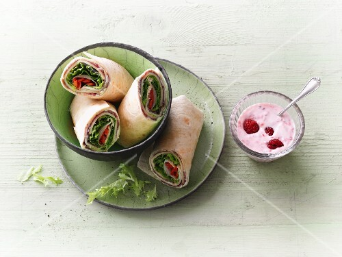 Ham and cheese wraps with vegetables and raspberry yoghurt