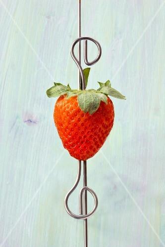 A fresh strawberry on a skewer