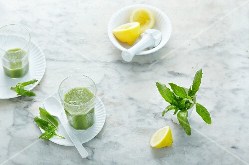 Green smoothies with basil and lemon
