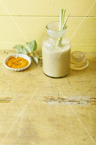 An apple and banana smoothie with almond milk, lemongrass and turmeric