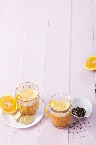 Pineapple and orange smoothies with ginger, turmeric and pepper