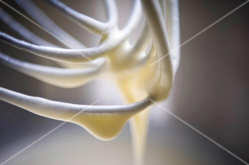 A close up of batter on a whisk