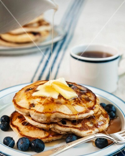 Stack of Blueberry Pancakes with Butter and Maple Syrup