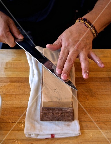 A Japanese knife being sharpened