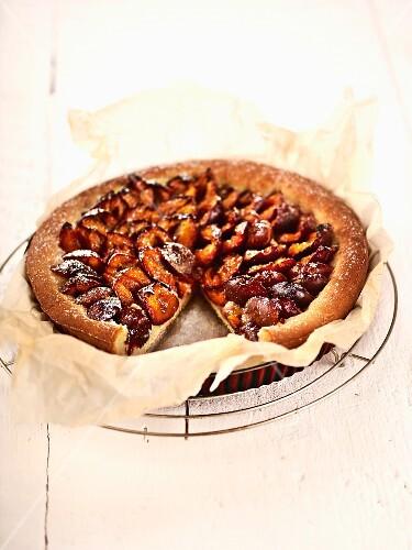 Damson tart on baking paper