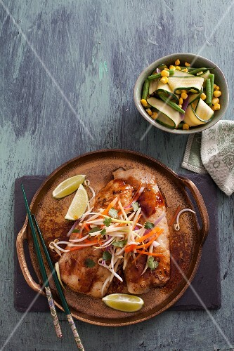 Fish fillet with vegetables in an oriental marinade