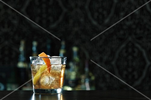 An Old Fashioned cocktail on a bar
