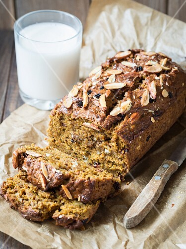 Vegan gingerbread and pumpkin cake with almonds and cranberries