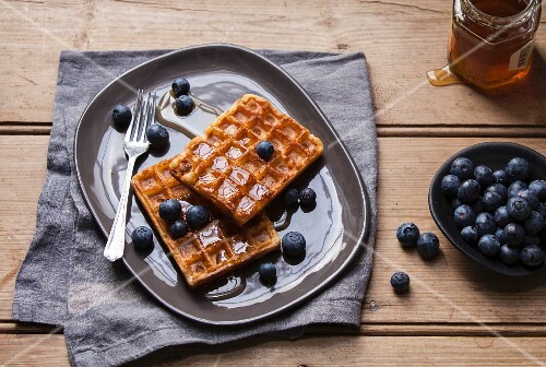 Belgian waffles with blueberries and honey