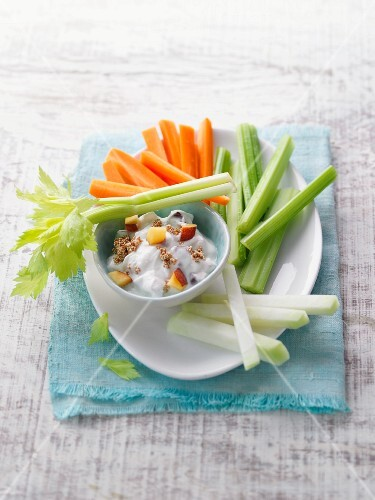Colourful vegetable sticks with a peach and ricotta dip