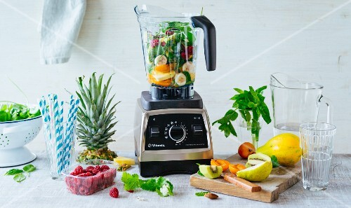 Smoothie fasting: a blender with fruit and vegetables, water and herbs