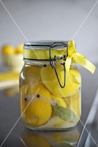 A jar of pickled salted lemons