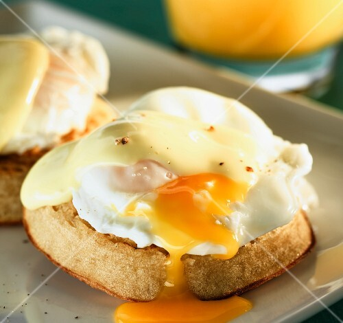 A poached egg with Hollandaise sauce on a muffin