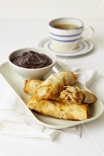 Sweet spring rolls filled with banana and served with a chocolate dip