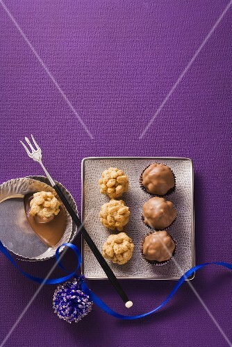 Marzipan sweets with oat crispies and chocolate glaze