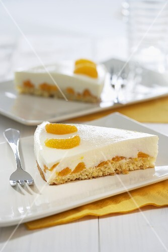 Two slices of mandarin and yoghurt tart