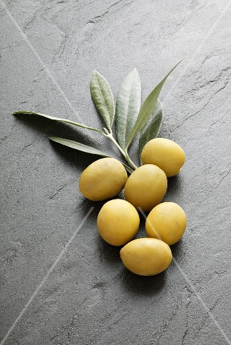 Green olives and olive leaves