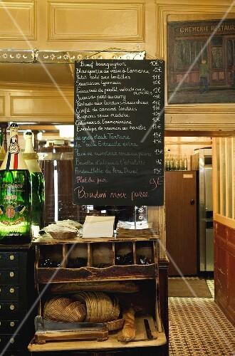 A menu board in a French restaurant