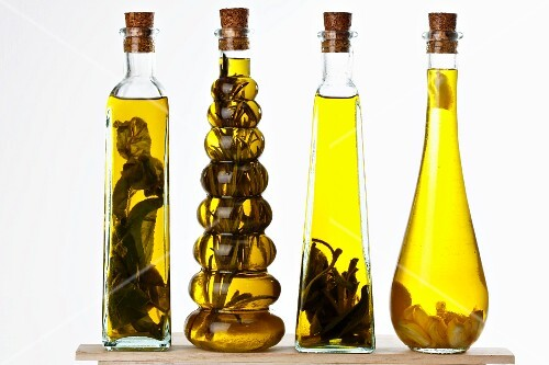 Bottles of olive oil with various aromas