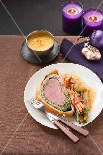 Fillet Wellington with vegetables and saffron sauce for Christmas dinner