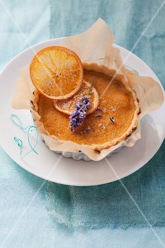 An orange tartlet with a sage flower