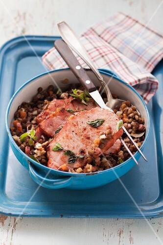 Smoked pork chop on a lentil medley