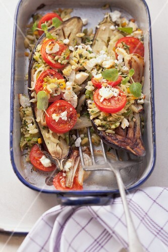 Aubergines stuffed with orzo pasta, tomatoes and feta cheese