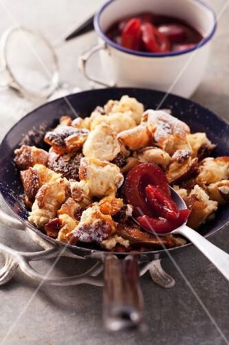 Shredded quark pancakes with roasted damsons