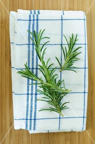 Rosemary sprigs on a tea towel