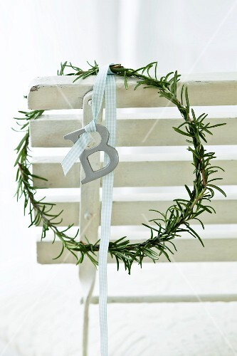 A wreath of rosemary hanging over the back of a chair