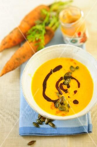 Carrot soup with pumpkin seeds