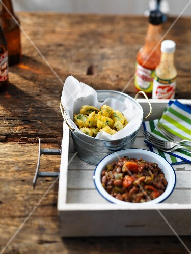 Side dishes for a barbecue:battered okra and baked beans (USA)
