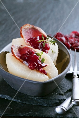Pears filled with smoked goose breast and dried cranberries