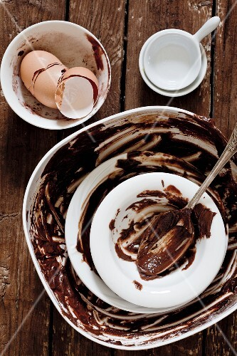 Bowls with the remains of a chocolate cake mixture and eggshells