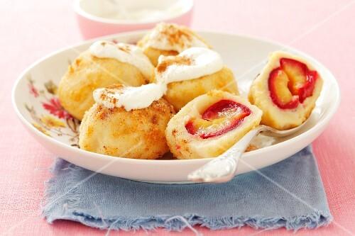 Damson dumplings with cinnamon sugar and cream