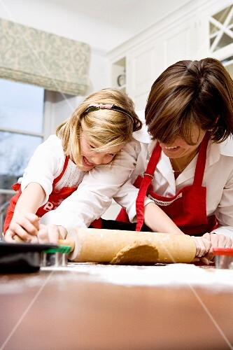 A mother and daughter baking together