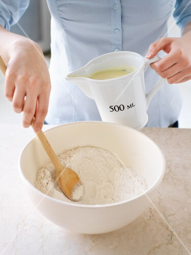 Woman preparing pancake batter