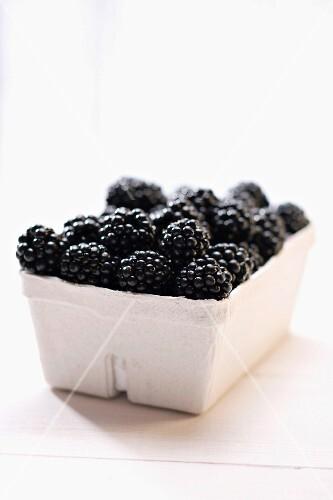 Blackberries in cardboard punnet