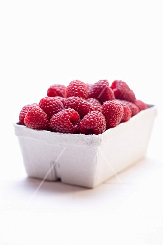 Raspberries in cardboard punnet