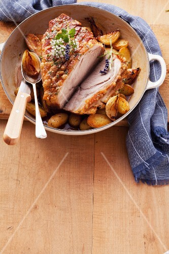Roast pork with potatoes and onions