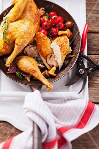 Roast chicken with wild mushrooms and cherry tomatoes