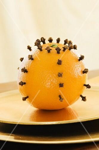 An orange pierced with cloves