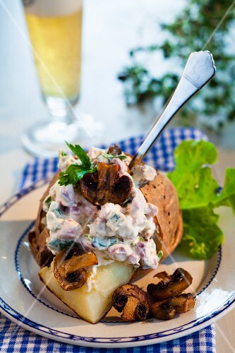 Baked potato with mushroom and bacon filling