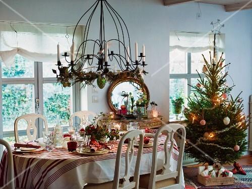 Festive Christmas table next to Christmas tree