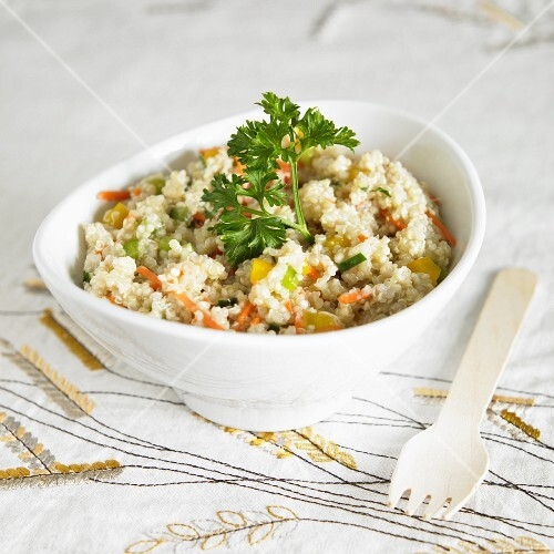 Bowl of Gluten Free Summer Quinoa Salad with Carrots, Peppers and Zucchini