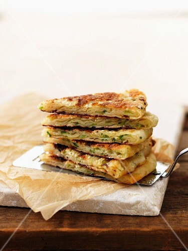 Chinese pancakes with spring onions on a cake slice