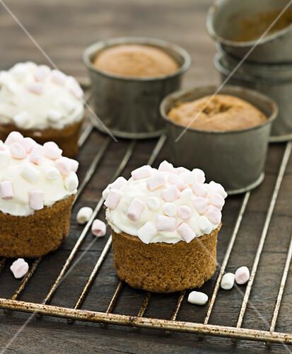 Pumpkin cupcakes topped with mini marshmallows