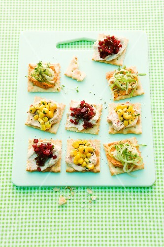 Party crackers topped with cucumber, beetroot and sweetcorn