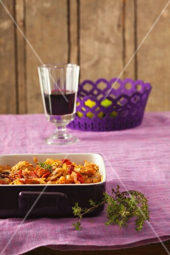 Cabbage casserole with wild boar sausage and thyme